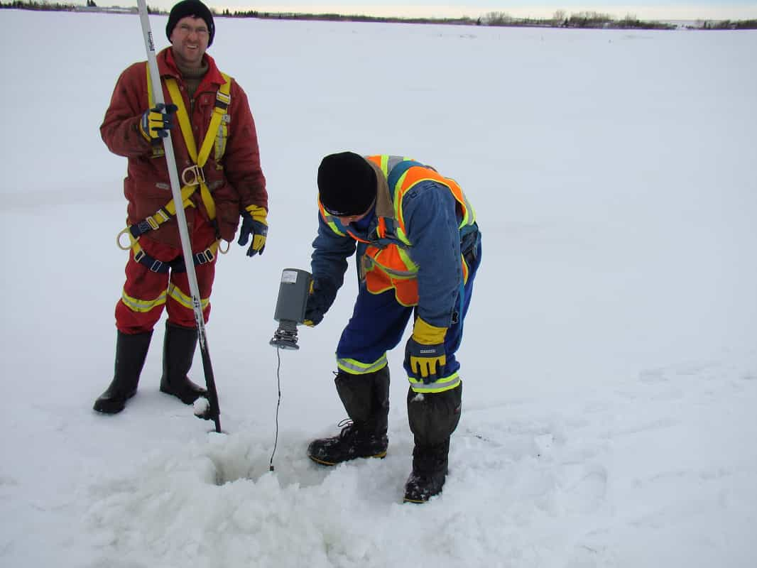 lambourne employees safely performing a winter lagoon survey